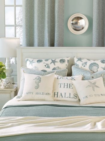 Coastal-Tidings-Pillows-on-Bed